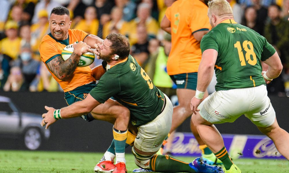 Quade Cooper is tackled be Duane Vermeulen